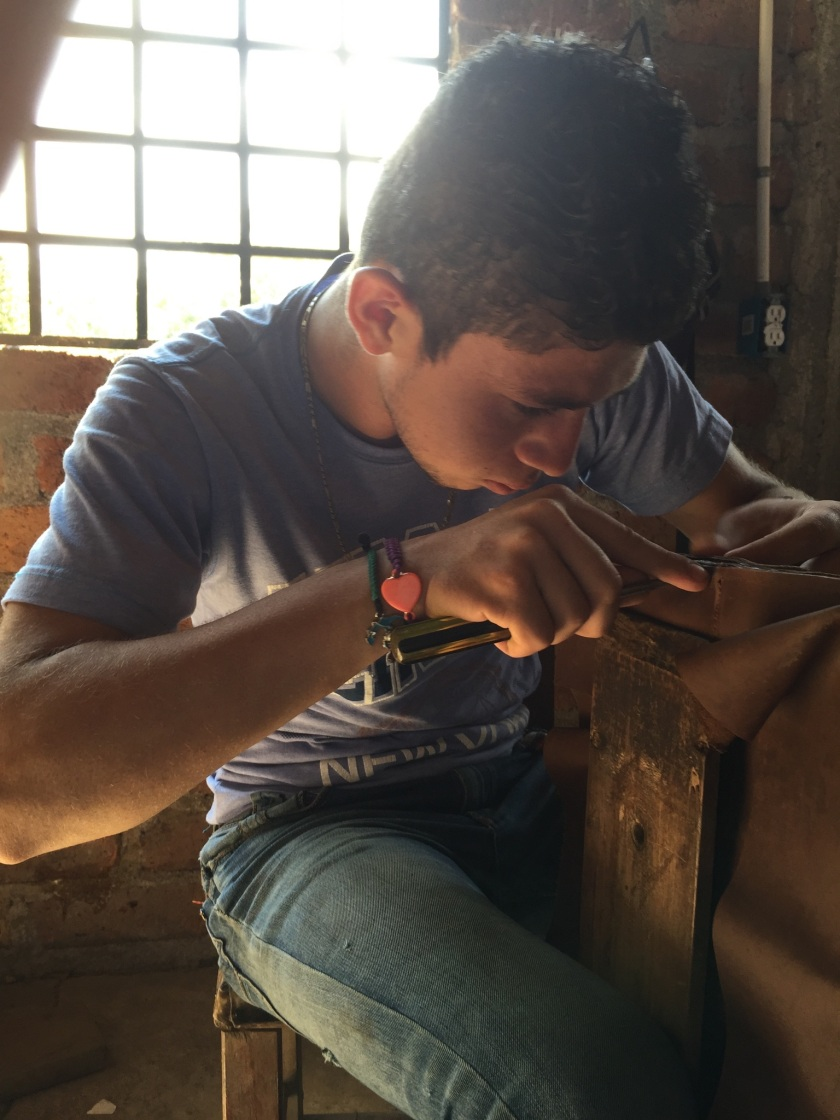 Learning the leather trade at Mission Lazarus. Photo Pamela Klein.