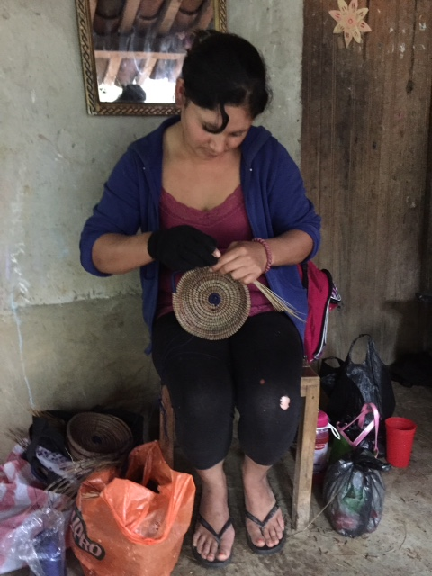 Mothers making beautiful pine straw baskets at Solo Hope. Photo by Pamela Klein.